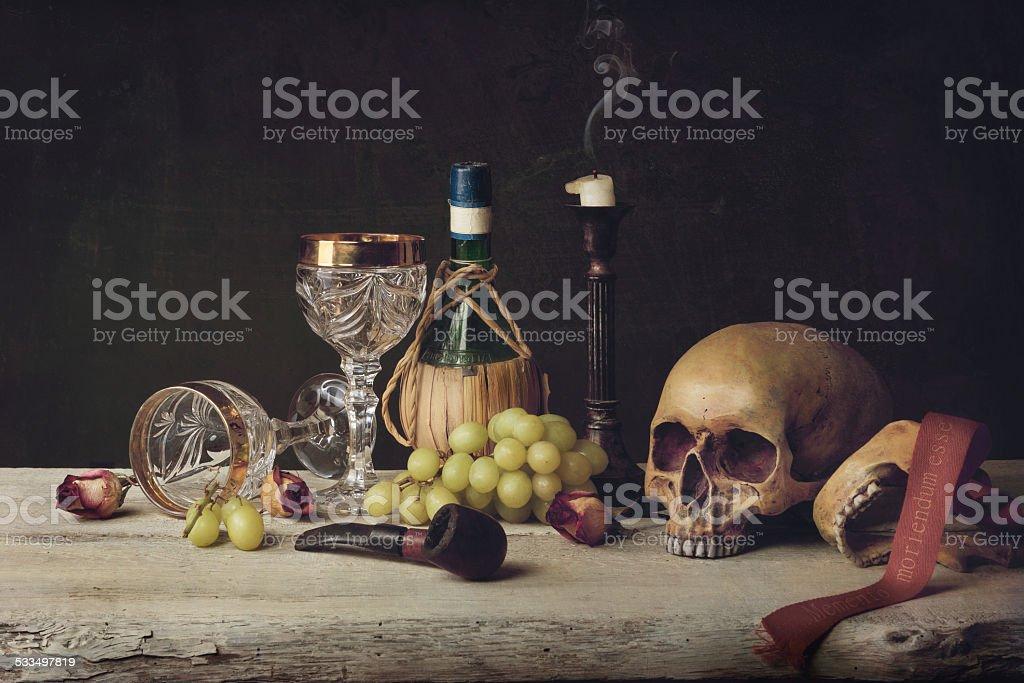 Vanitas witch Skull; Pipe, tobacco, wine glass, wine and grape stock photo