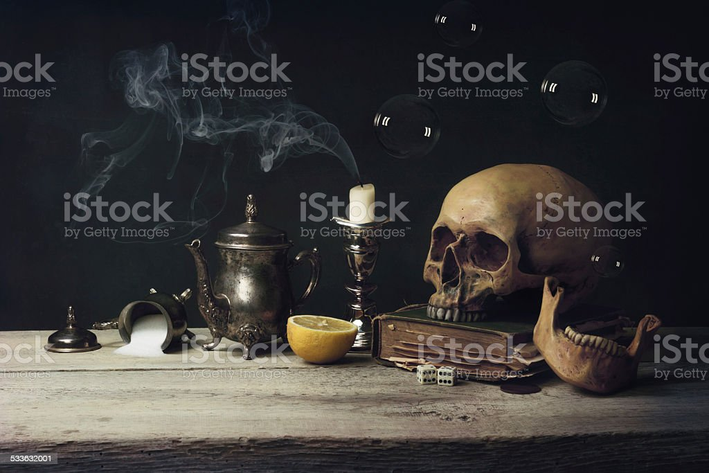 Vanitas with Skull and Tea Set, Book and Soap Bubbles stock photo