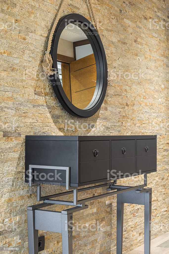Vanity against brick wall stock photo