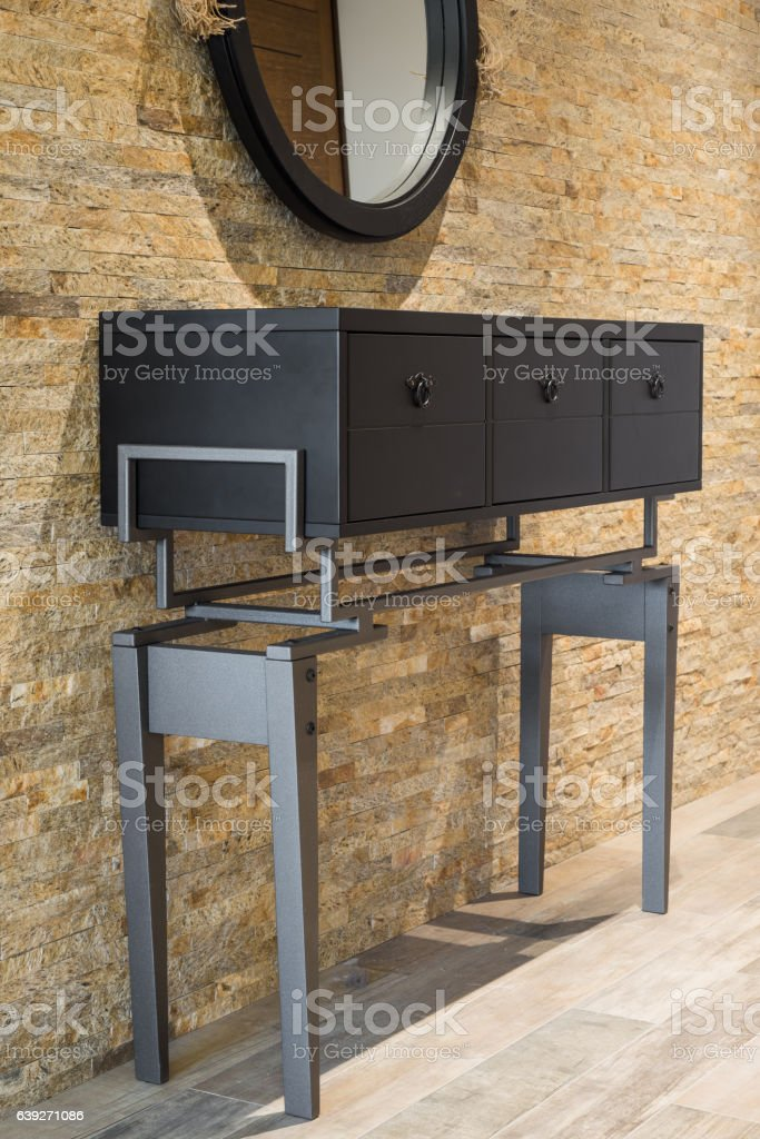 Vanity against brickwall old fashioned dressing table stock photo