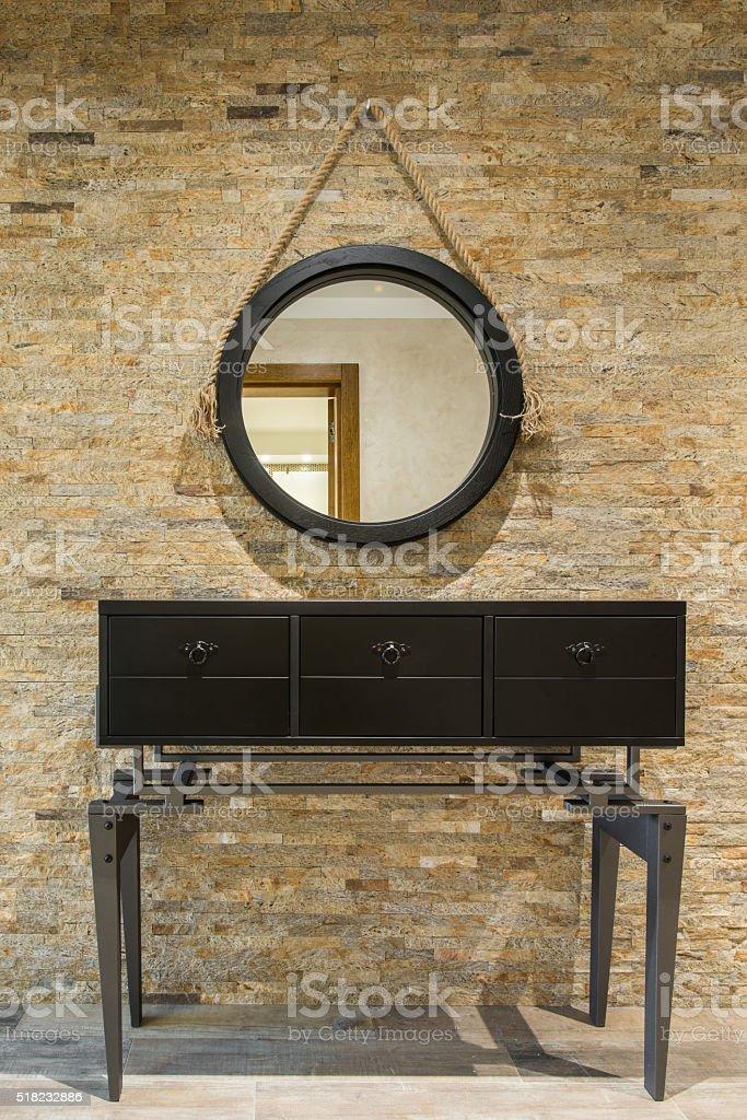 Vanity against brickwall stock photo