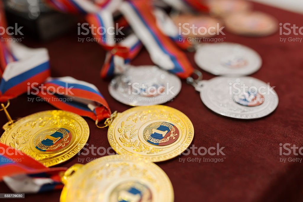 Vanquish the medals for the competition on table stock photo