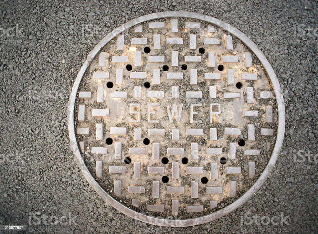 Vanted Manhole Sewer Main Cover Asphalt Side Street Water Drain stock photo