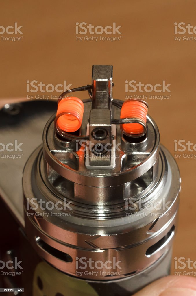 vape, ecigarette atomizer on wooden background stock photo