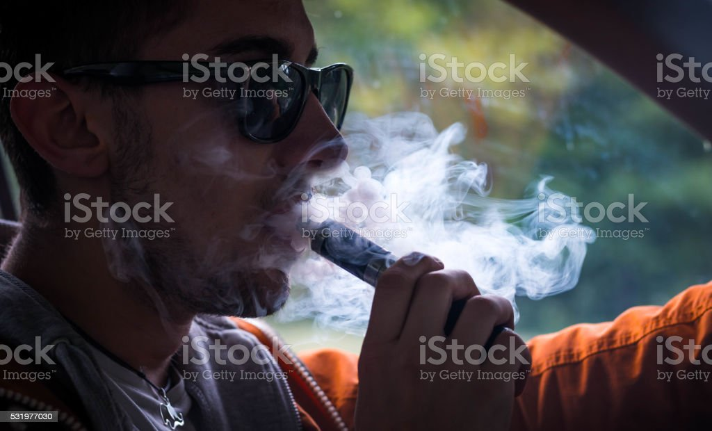 Vaping and driving stock photo