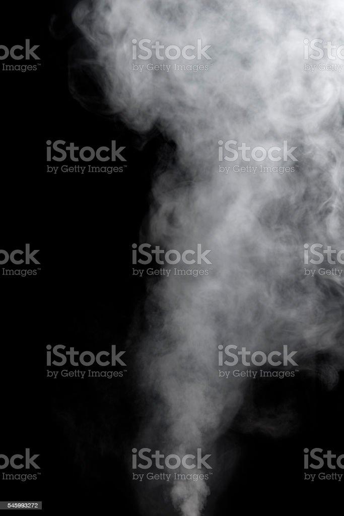 Vaping smoke on black background. stock photo