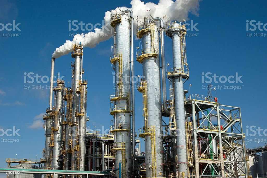 Vapor leaves exhaust pipes of a heavy industrial facility stock photo