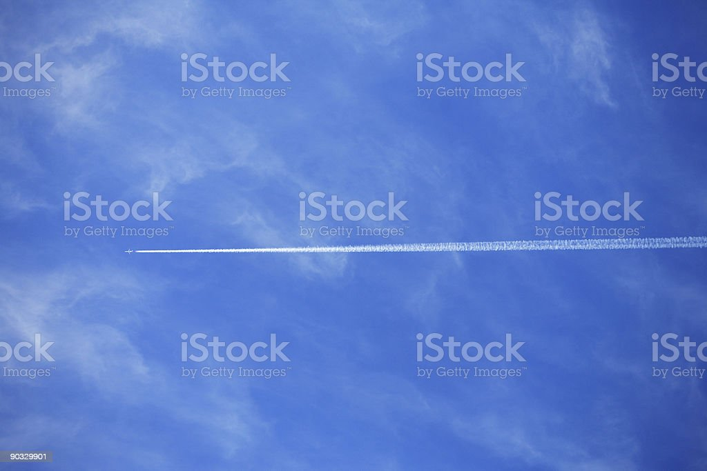 Vapor trail of a plane in the sky royalty-free stock photo