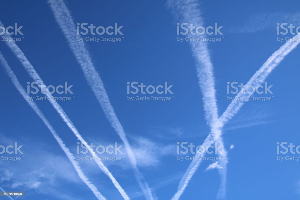 Vapor Trails in the blue sky stock photo
