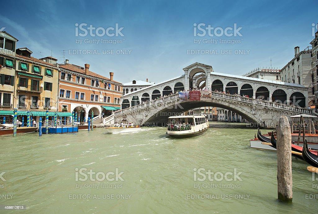 Vaporetto boat under Rialo Bridge, Canale Grande, Venice, Italy royalty-free stock photo