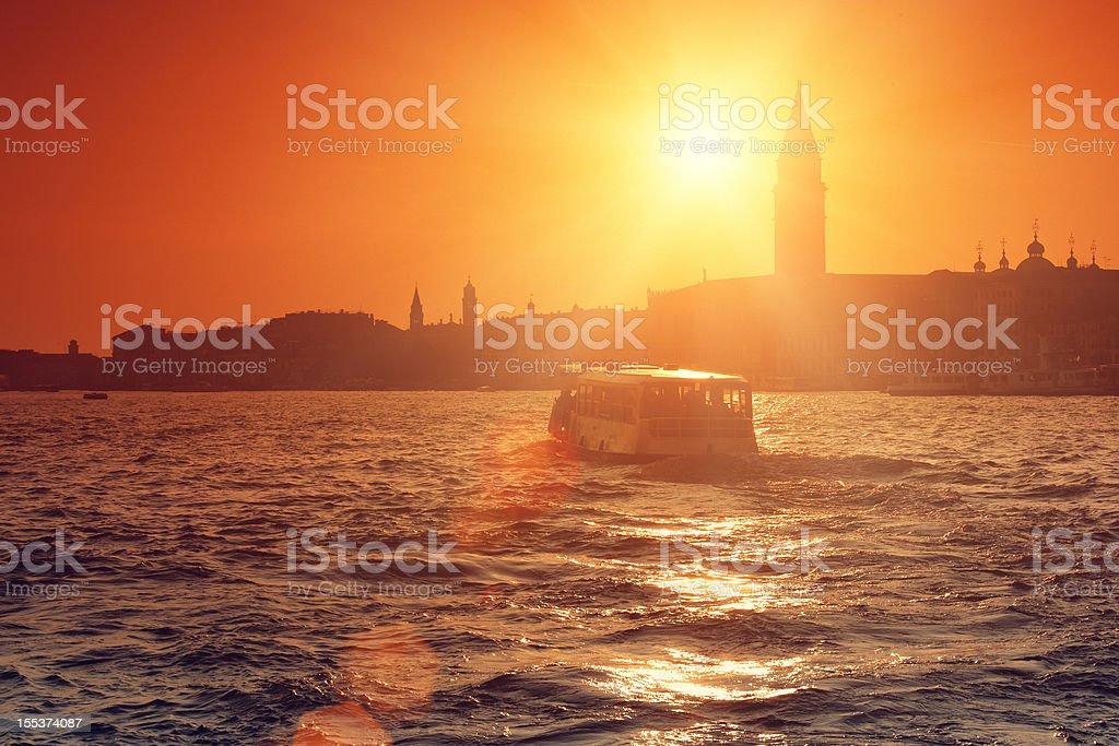 Vaporetto on the lagoon of Venice at sunset stock photo