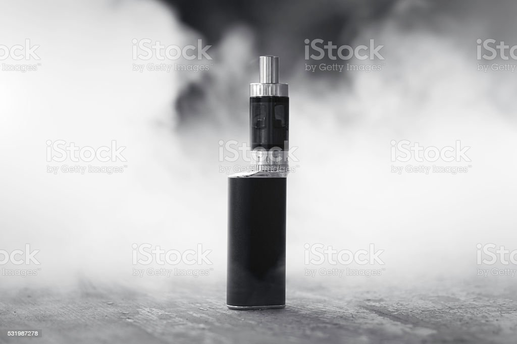 Vaporizer in smoke stock photo