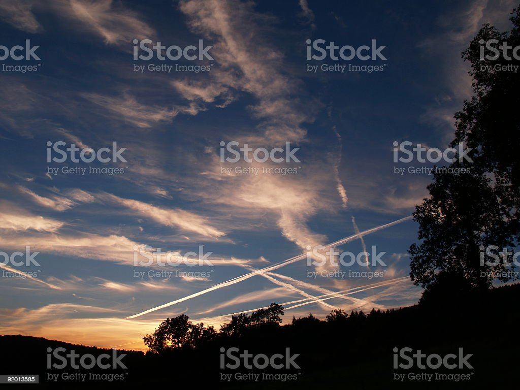 Vapour trails into Manchester Airport royalty-free stock photo