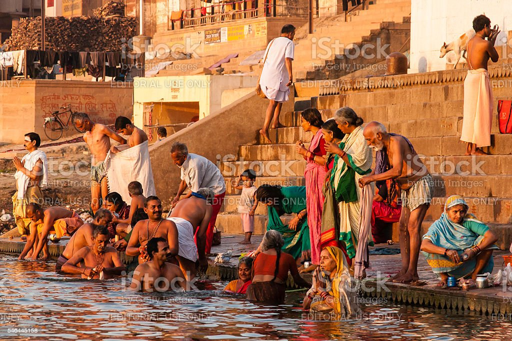 Varanasi, India: People Performing Morning Ablutions on the Ganges stock photo