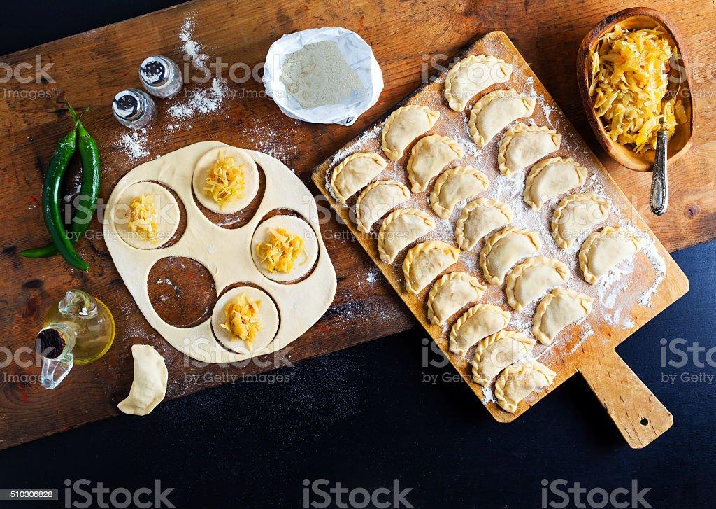 Vareniki with cabbage ( dumplings ) , pierogi before boiling stock photo