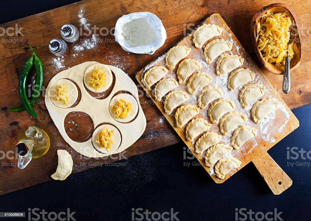 Vareniki with cabbage ( dumplings ) , pierogi before boiling stock photo