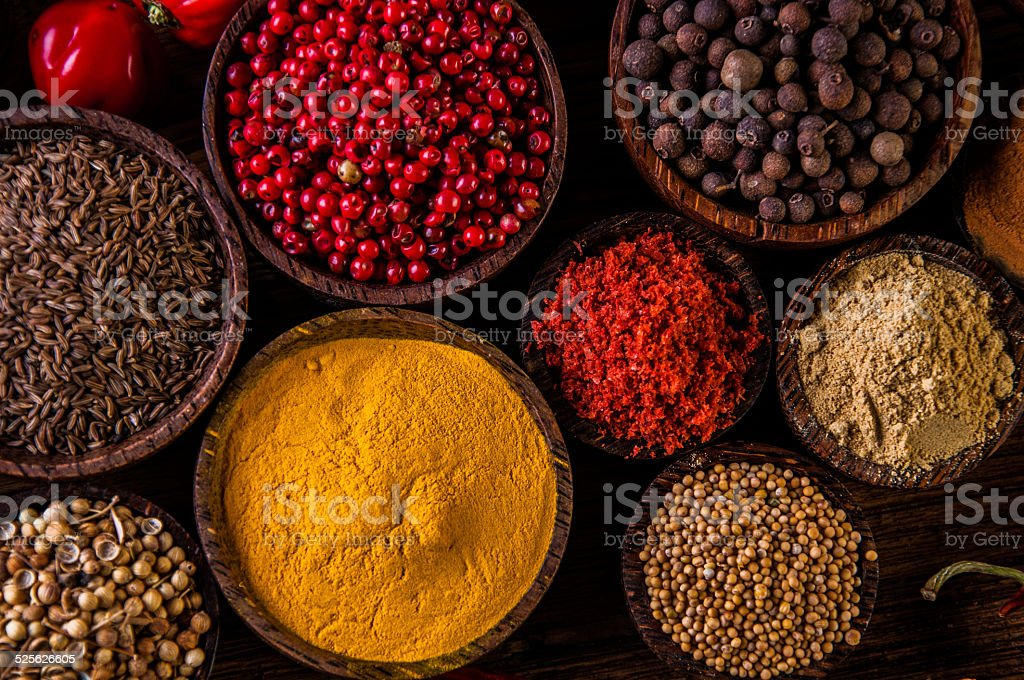 Variability of Asian spices on wooden table stock photo