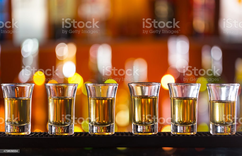 Variation of hard alcoholic shots on bar counter stock photo