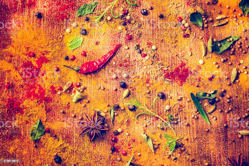 Variation of Spices and Herbs on Wooden Background stock photo