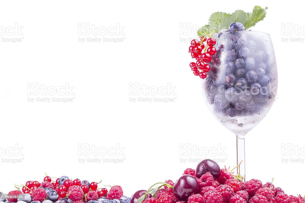 Varied berries in glass with leaf isolated on white background royalty-free stock photo