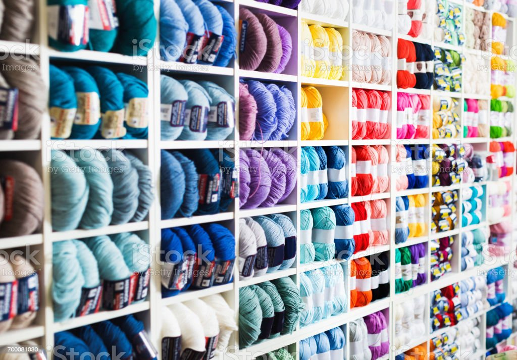 Variegated yarns for knitting on shop shelf stock photo