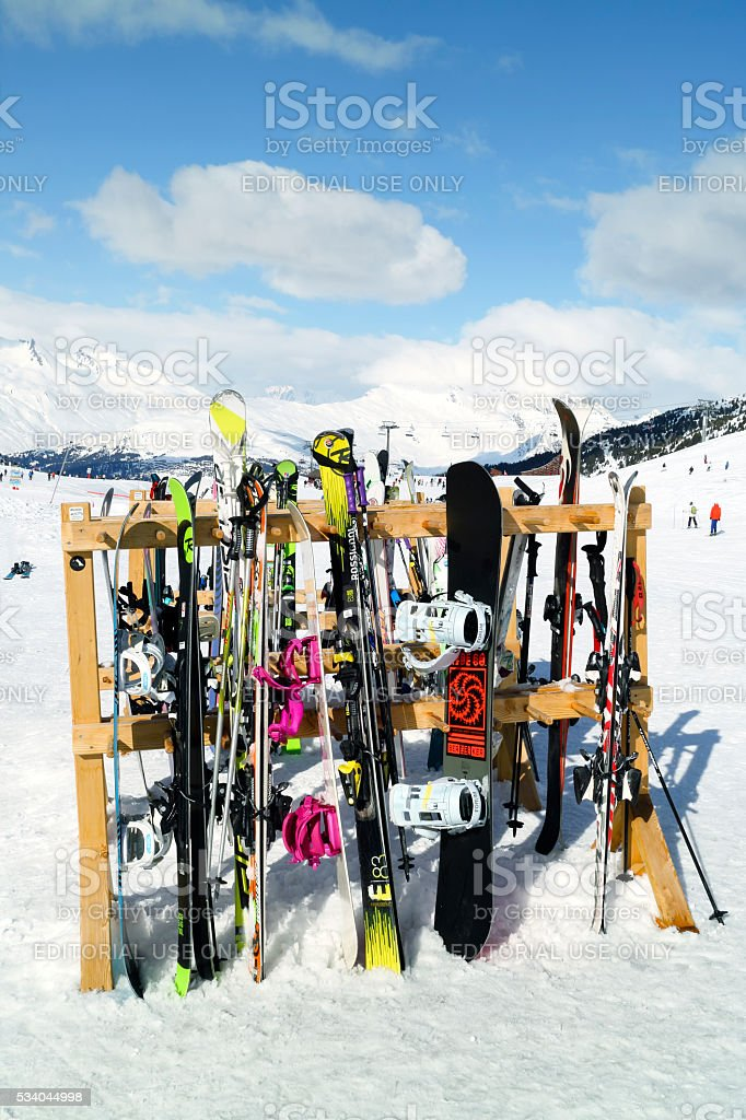 Varies ski and snowboard equipment in snowy mountains stock photo