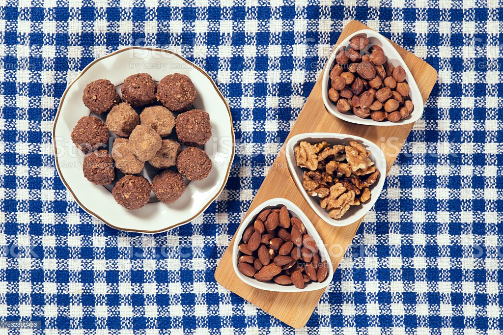 Varieties of nuts: almonds, hazelnuts and walnuts and chocolate balls stock photo