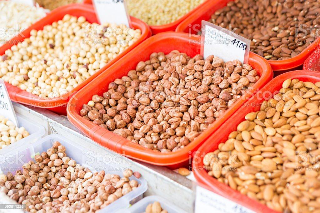 Varieties of nuts on market stall stock photo