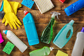 Variety cleaning supplies on wooden table, top view