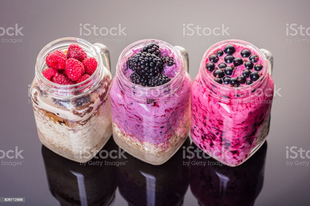 variety oatmeal with fresh berries stock photo