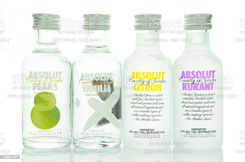 Variety of Absolut flavoured vodka isolated on white stock photo