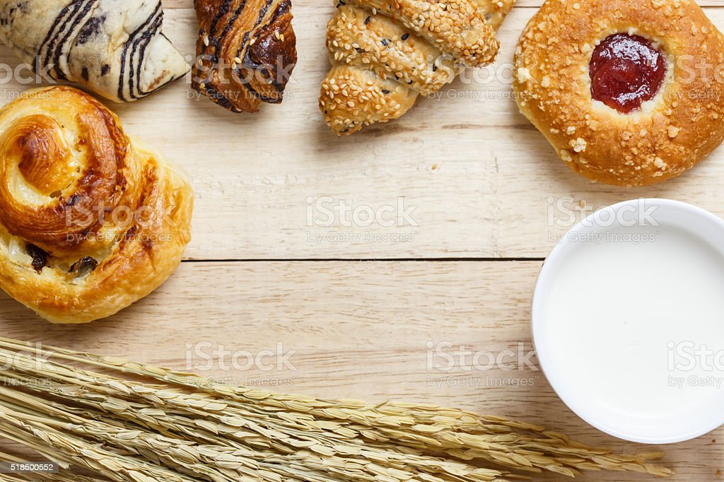 Variety of bakery products on wood plate background stock photo