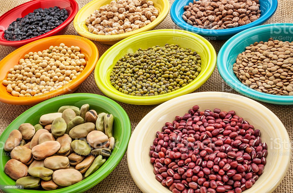 variety of beans in bowls stock photo