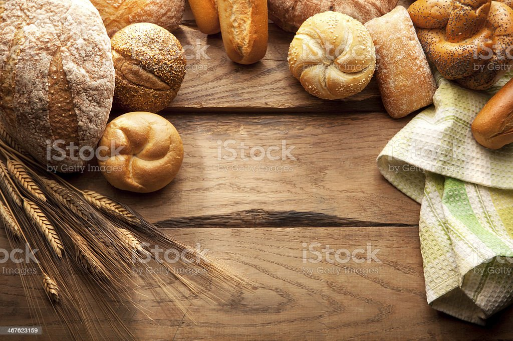 Variety of Bread on wooden table stock photo
