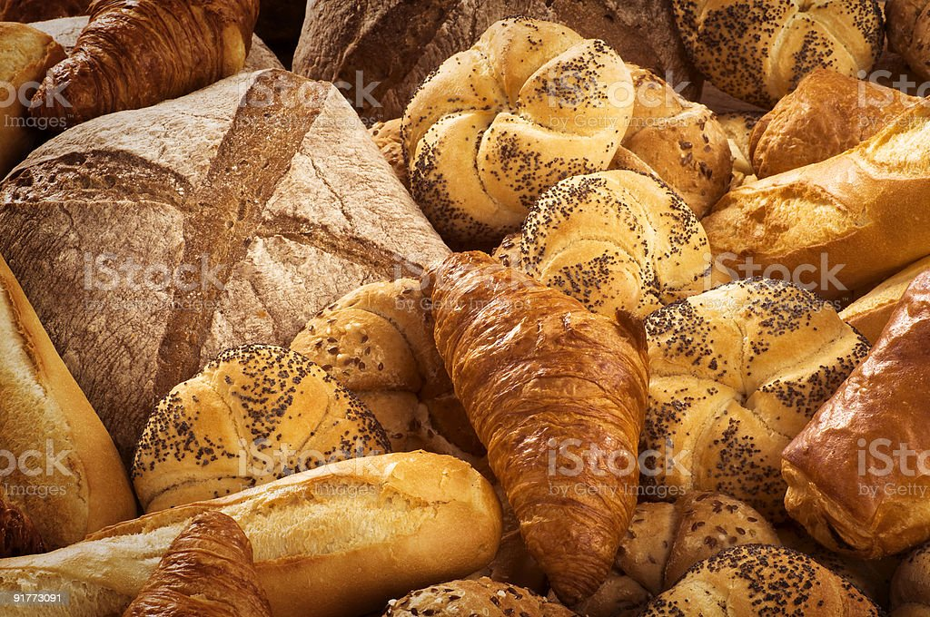 Variety of breads on piles of dough royalty-free stock photo