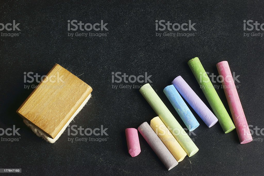 Variety of Chalk and Duster on Slate royalty-free stock photo