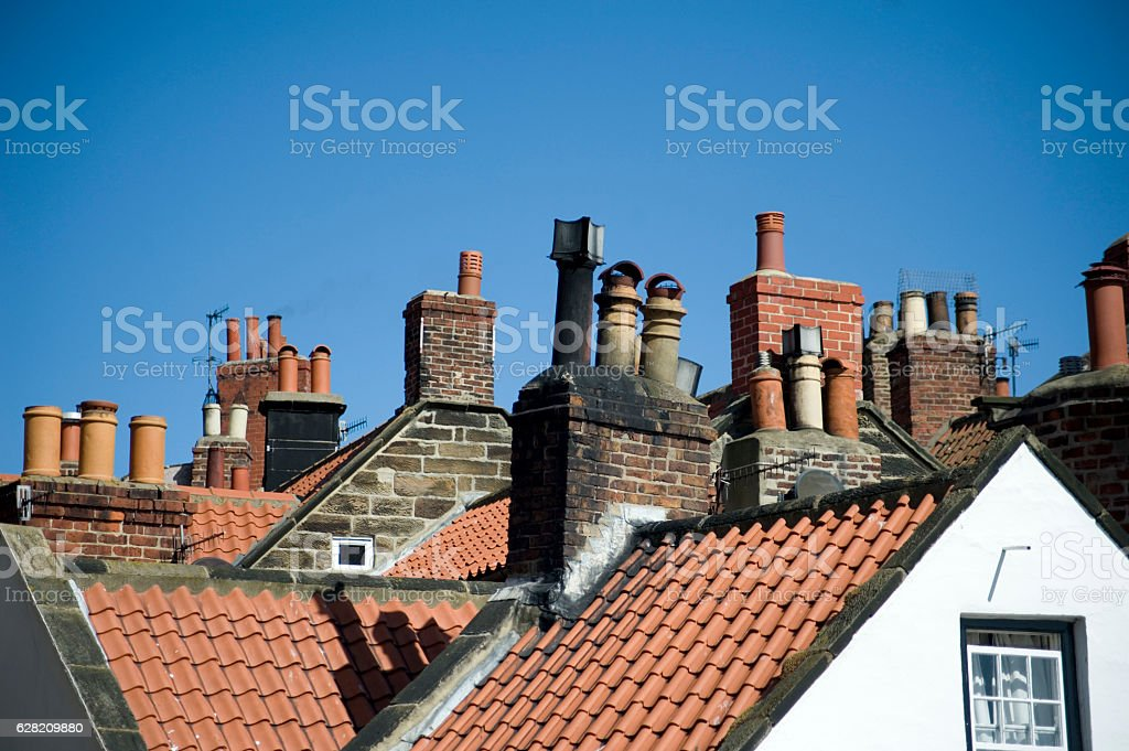 Variety of chimney pots in Robin Hoods Bay stock photo