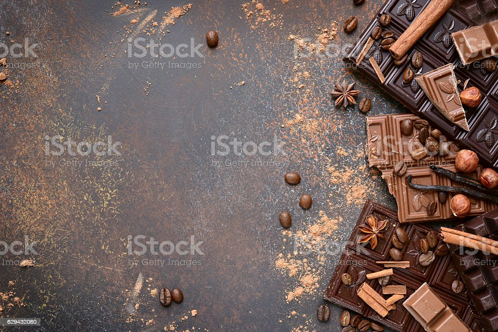 Variety of chocolate bars with spices.Top view. stock photo