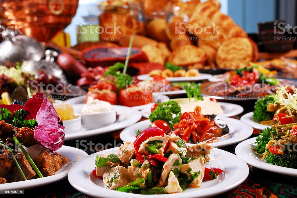 Variety of colorful ethnic foods plated artistically stock photo