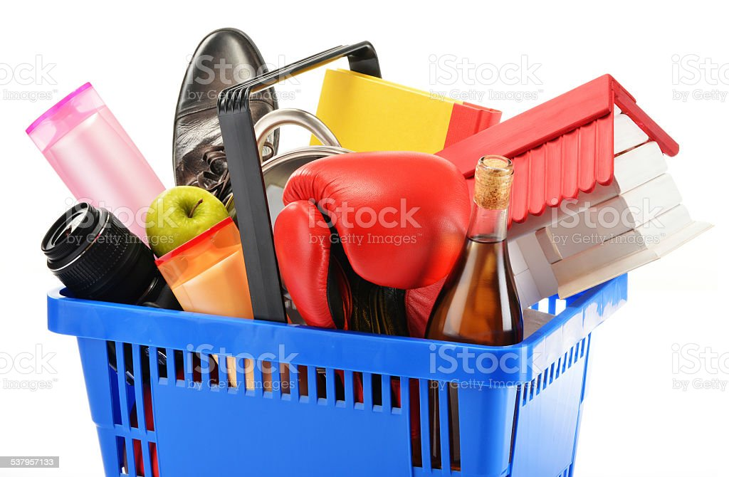 Variety of consumer products in plastic shopping basket isolated stock photo