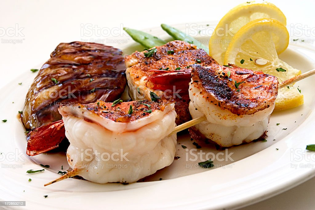 A variety of cooked seafood with garnishes royalty-free stock photo