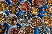 variety of copper, silver, and gold rings in Indian market.