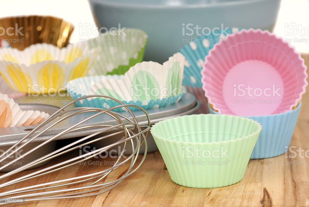 Variety of cupcake liners with wire wisk stock photo