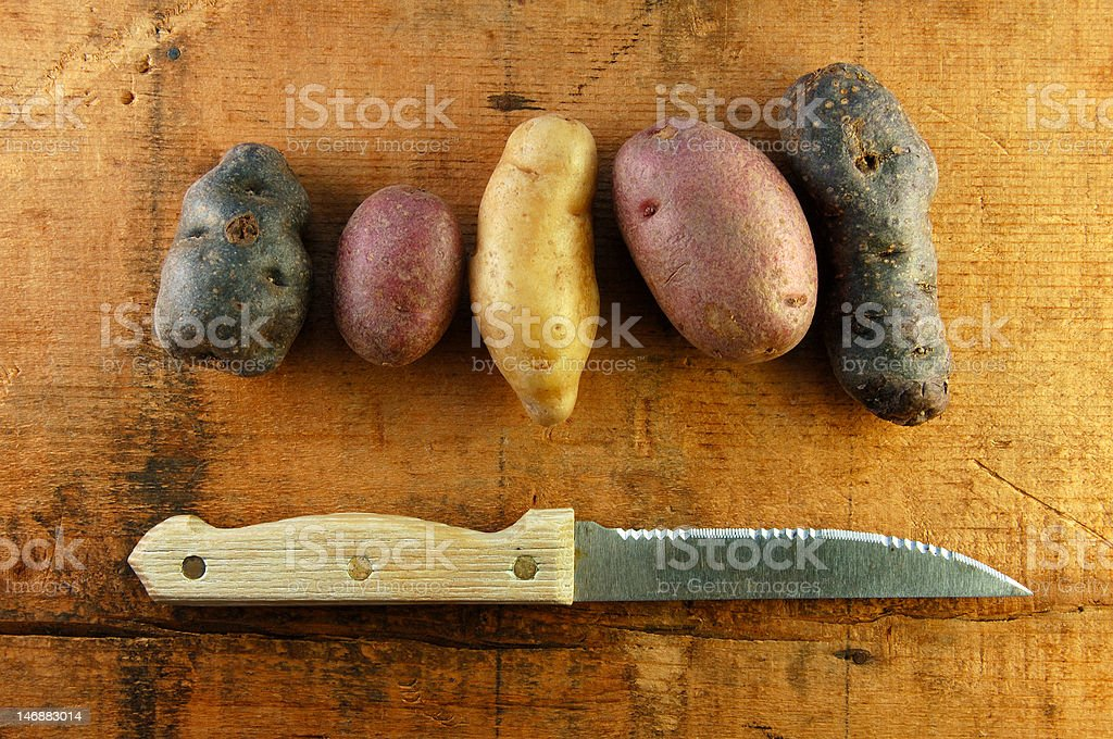 Variety of Fingerling Potatoes on Wooden Table royalty-free stock photo