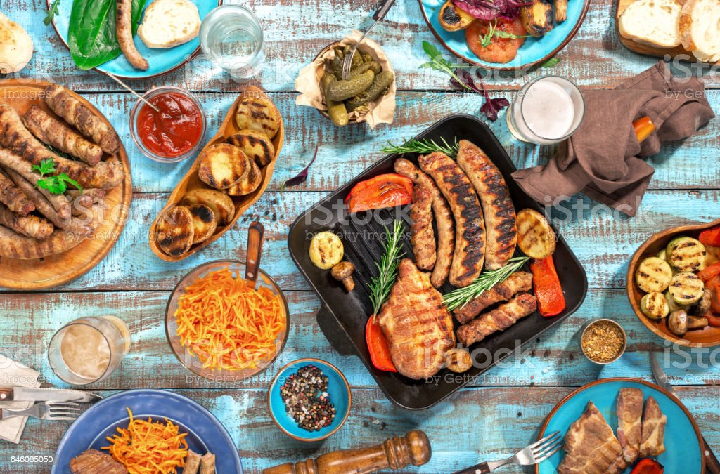 Variety of food grilled on wooden table, top view stock photo