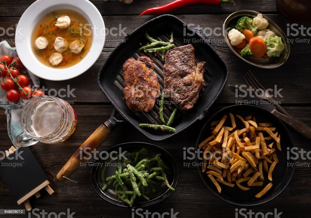 Variety of food on wooden table stock photo