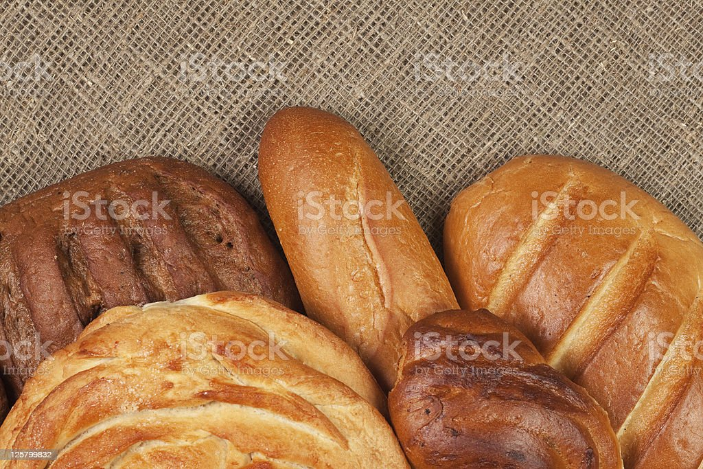 variety of fresh bread over sackcloth background royalty-free stock photo