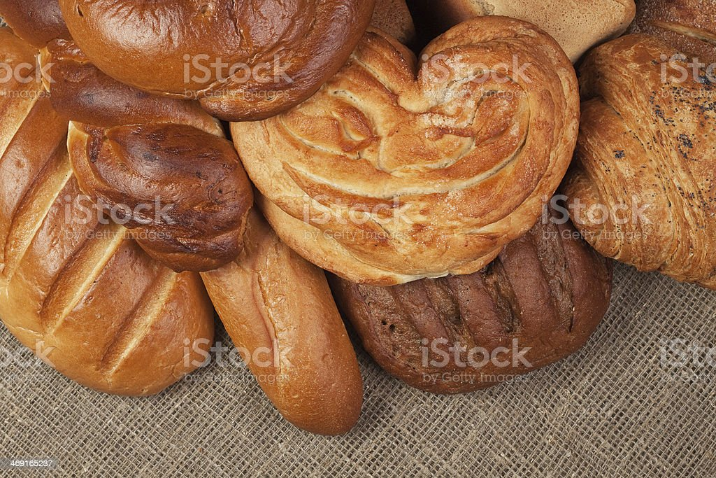 variety of fresh bread over sacking background royalty-free stock photo