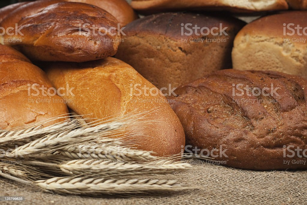 variety of fresh bread with rye ears royalty-free stock photo