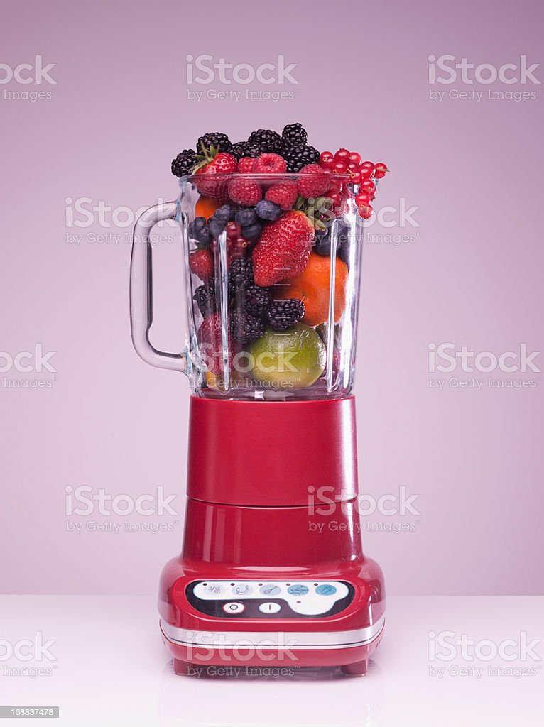 Variety of fruit crammed in blender royalty-free stock photo